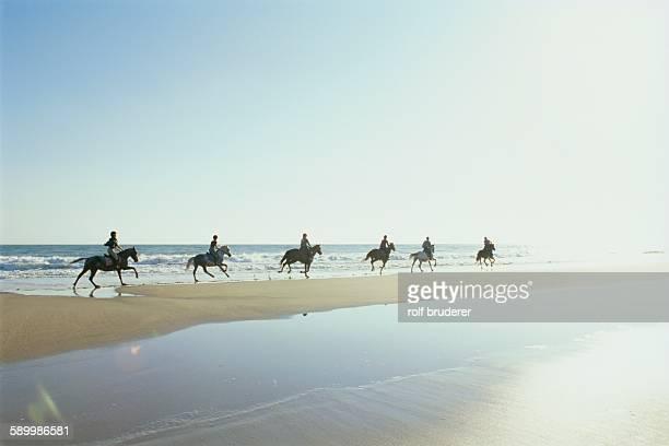 Riding Horses at Beach