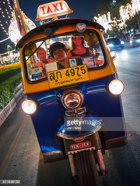 Riding in a Bangkok tuk tuk.