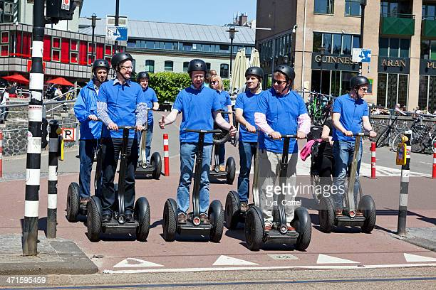 riding in amsterdam - segway stock pictures, royalty-free photos & images