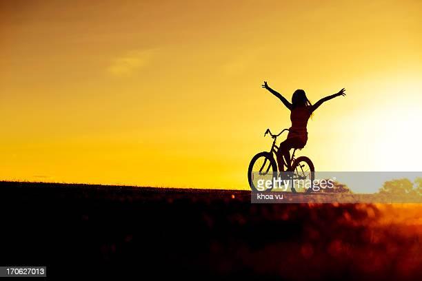 Riding into sun set