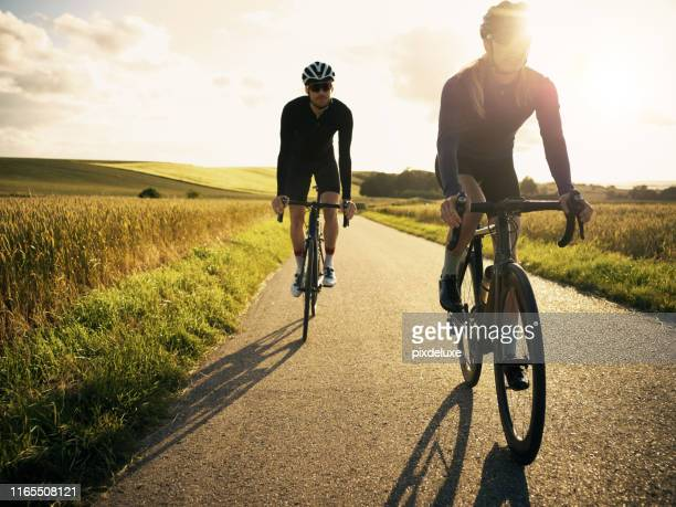 riding is much more fun together - cycling stock pictures, royalty-free photos & images