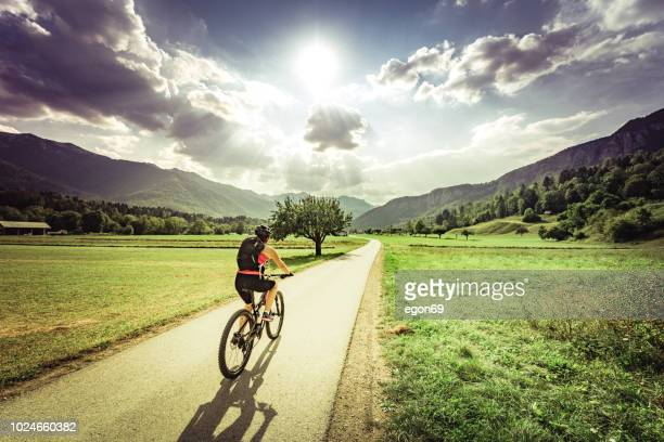 riding moutain bike - slovenia stock pictures, royalty-free photos & images