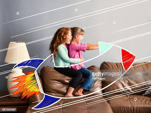riding on a sofa rocketship - animation stock pictures, royalty-free photos & images