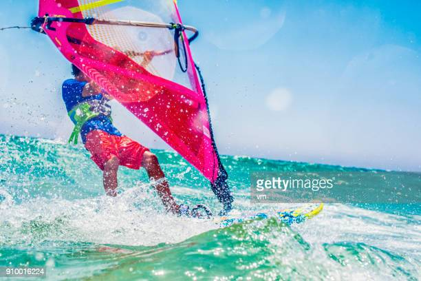 riding on water - windsurfing stock pictures, royalty-free photos & images
