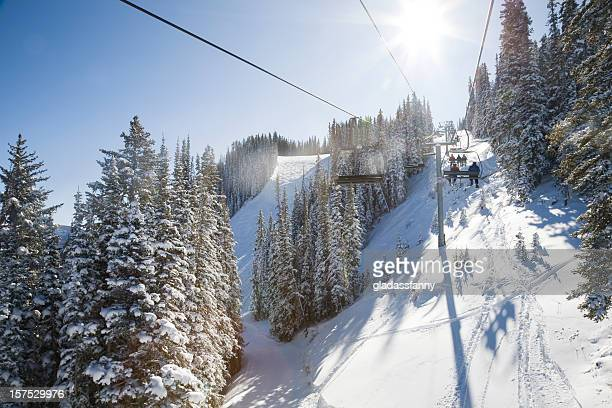riding the chair at aspen - ski lift stock pictures, royalty-free photos & images
