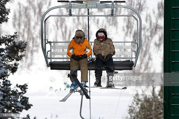 riding the ski lift - ski lift stock pictures, royalty-free photos & images