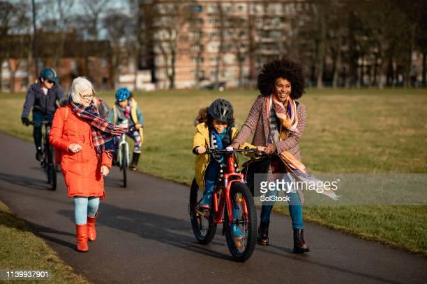 riding through the park - public park stock pictures, royalty-free photos & images