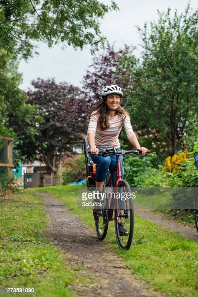 riding through the park - mature women stock pictures, royalty-free photos & images