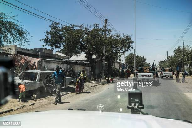 Riding with a UN convoy with security forces in central Mogadishu Somalia is in the grip of an intense drought induced by consecutive seasons of poor...