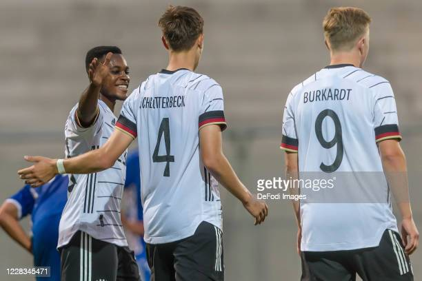 Ridle Baku of Germany U21 and Nico Schlotterbeck of Germany U21 celebrates after scoring his team's third goal with teammates during the UEFA Euro...