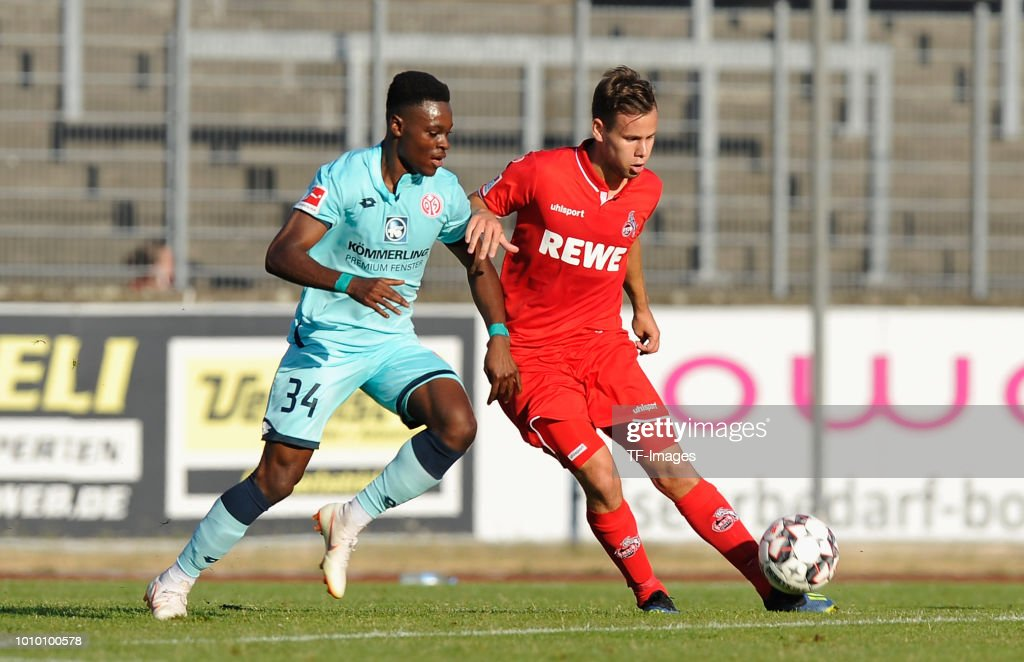 Ridle Baku of Mainz and Louis Schaub of Koeln battle for the ball during the pre-season friendly match between 1. FC Koeln and 1. FSV Mainz 05 at Sportpark Nord on July 27, 2018 in Bonn, Germany.