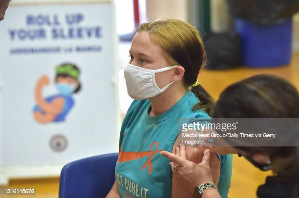 Junior Molly Day gets her first Pfizer Biontech COVID vaccine at Ridley High School Monday afternoon May 2021 as part of a clinic for students age...