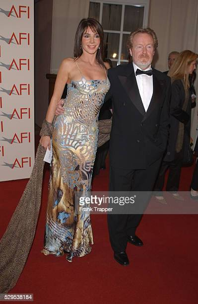 """Ridley Scott and girlfriend Gianina Facio at the first annual AFI Awards 2001. Scott was nominated for AFI Director of the Year for his film """"Black..."""