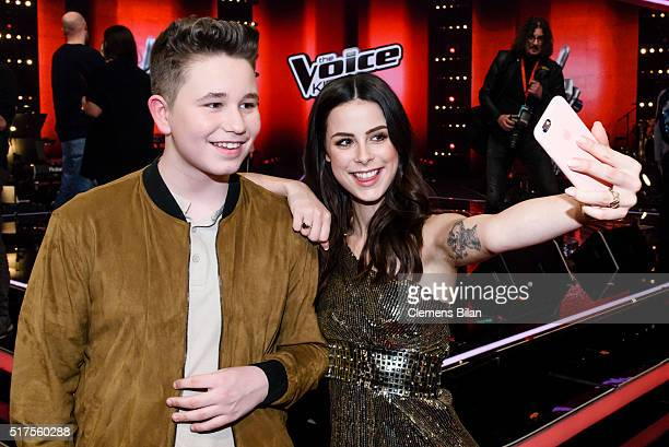Ridon Jakupi and Lena MeyerLandrut take a selfie during the 'The Voice Kids' Finals on March 25 2016 in Berlin Germany