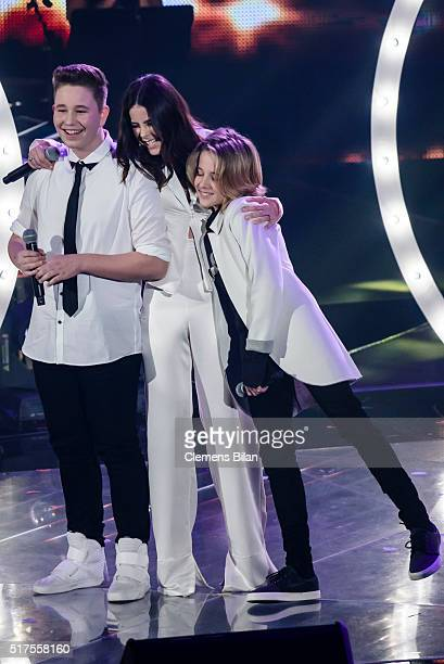 Ridon Jakupi Lena MeyerLandrut and Matteo Markus are seen on stage during the 'The Voice Kids' Finals on March 25 2016 in Berlin Germany