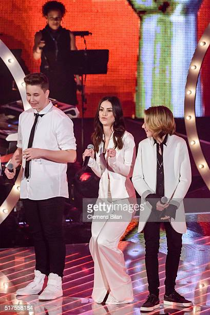 Ridon Jakupi Lena MeyerLandrut and Matteo Markus perform on stage during the 'The Voice Kids' Finals on March 25 2016 in Berlin Germany