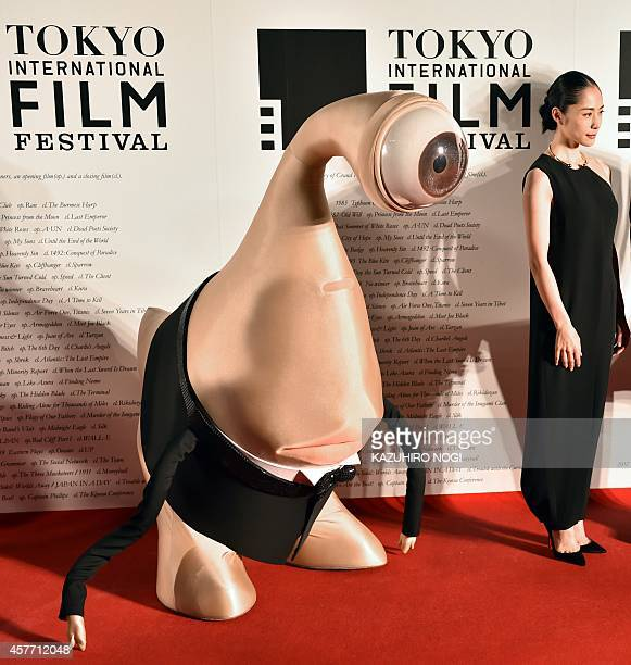 """Rie Fukatsu , Japanese actress from """"Parasyte"""" and manga character Migi pose on the red carpet for the 27th Tokyo International Film Festival opening..."""
