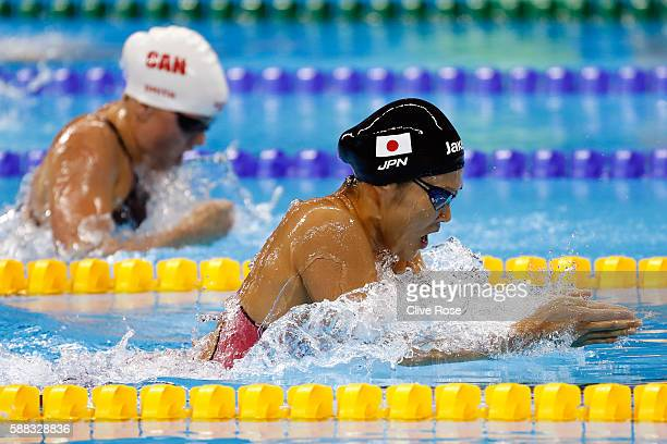 Rie Kaneto of Japan and Kierra Smith of Canada compete in the first Semifinal of the Women's 200m Breaststroke on Day 5 of the Rio 2016 Olympic Games...