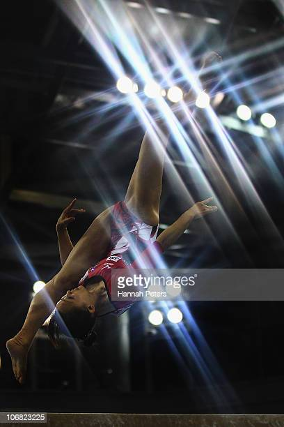 Rie Tanaka of Japan competes in the Women's Team Final beam discipline at the Asian Games Town Gymnasium during day two of the 16th Asian Games...