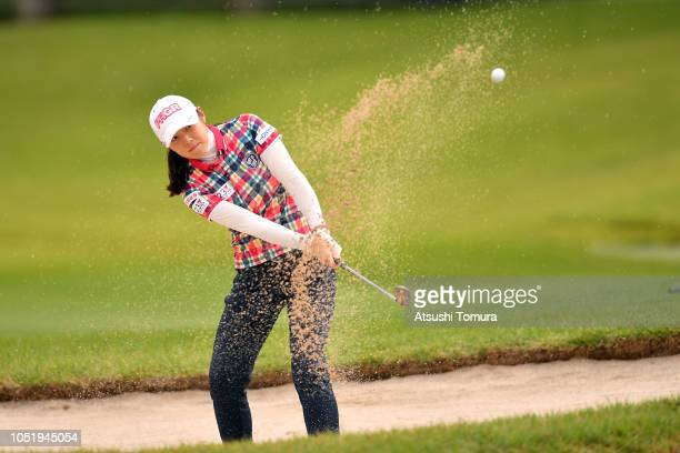 Rie Tsuji of Japan hits from a bunker on the 10th hole during the first round of the Fujitsu Ladies at Tokyu Seven Hundred Club on October 12 2018 in...