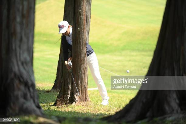Rie Tsuji of Japan hits her second shot from behind the tree on the 5th hole during the first round of the Fuji Sankei Ladies Classic at Kawana Hotel...
