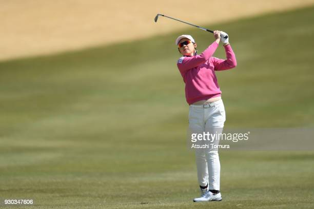Rie Tsuji of Japan hits her second shot on the 18th hole during the final round of the Tokohama Tire PRGR Ladies Cup at Tosa Country Club on March 11...