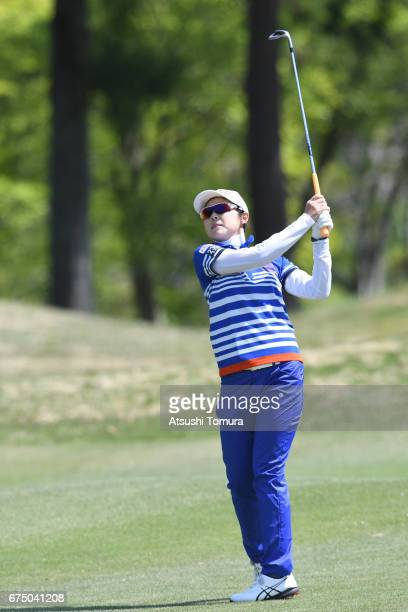 Rie Tsuji of Japan hits her second shot on the 5th hole during the final round of the CyberAgent Ladies Golf Tournament at the Grand Fields Country...