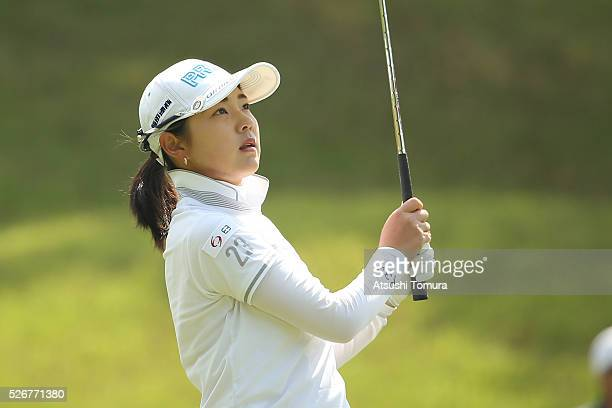 Rie Tsuji of Japan hits her third shot on the 5th hole during the final round of the CyberAgent Ladies Golf Tournament at the Grand Fields Country...