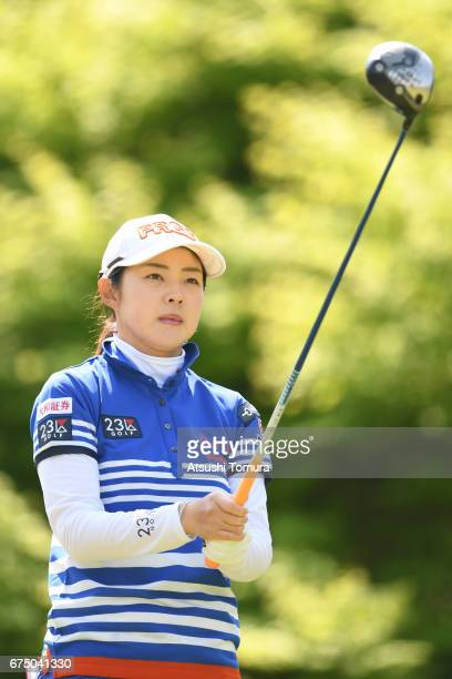 Rie Tsuji of Japan lines up her tee shot on the 2nd hole during the final round of the CyberAgent Ladies Golf Tournament at the Grand Fields Country...