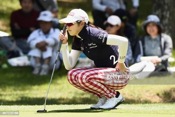 Rie Tsuji of Japan prepares to putt on the 11th green during the first round of the Hoken No Madoguchi Ladies at the Fukuoka Country Club on May 11...