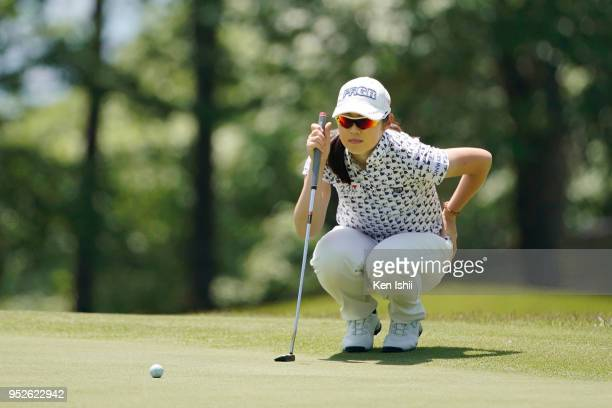 Rie Tsuji of Japan prepares to putt on the 15th green during the final round of the CyberAgent Ladies Golf Tournament at Grand fields Country Club on...