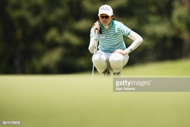 Rie Tsuji of Japan prepares to putt on the first green during the second round of the Hoken No Madoguchi Ladies at the Fukuoka Country Club on May 12...