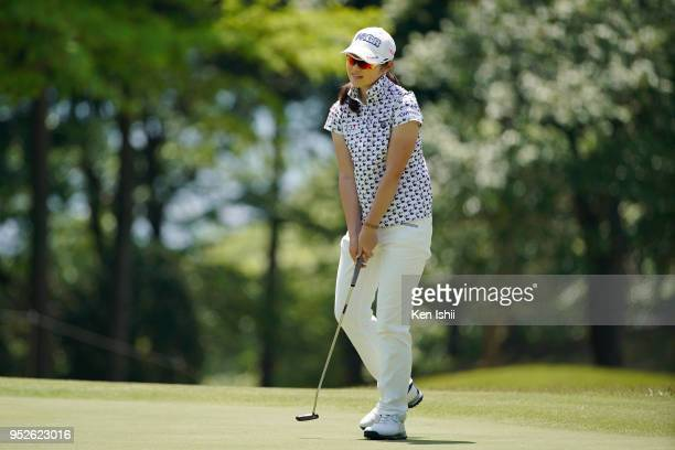 Rie Tsuji of Japan reacts after her putt on the 15th green during the final round of the CyberAgent Ladies Golf Tournament at Grand fields Country...