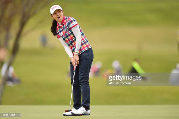 Rie Tsuji of Japan reacts after making her birdie putt on the 18th hole during the first round of the Fujitsu Ladies at Tokyu Seven Hundred Club on...