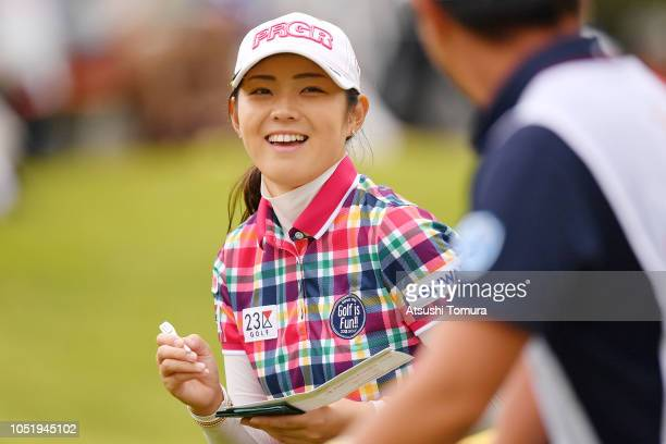 Rie Tsuji of Japan smiles after making her birdie putt on the 18th hole during the first round of the Fujitsu Ladies at Tokyu Seven Hundred Club on...