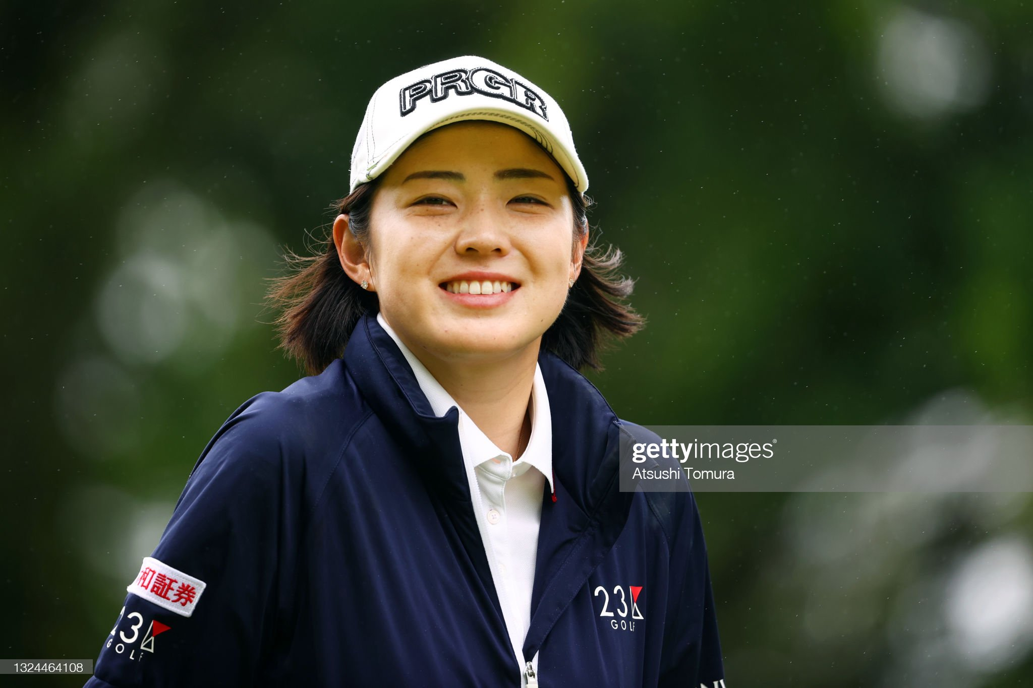 https://media.gettyimages.com/photos/rie-tsuji-of-japan-smiles-on-the-2nd-hole-during-the-final-round-of-picture-id1324464108?s=2048x2048