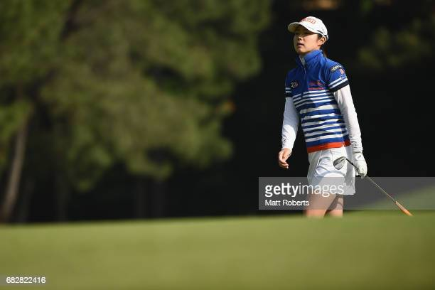 Rie Tsuji of Japan watches her approach shot on the 1st hole during the final round of the HokennoMadoguchi Ladies at the Fukuoka Country Club Wajiro...