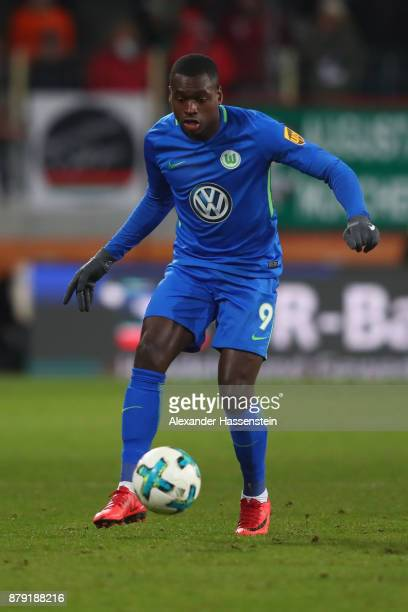 Riechedly Bazoer of Wolfsburg runs with the ball during the Bundesliga match between FC Augsburg and VfL Wolfsburg at WWKArena on November 25 2017 in...
