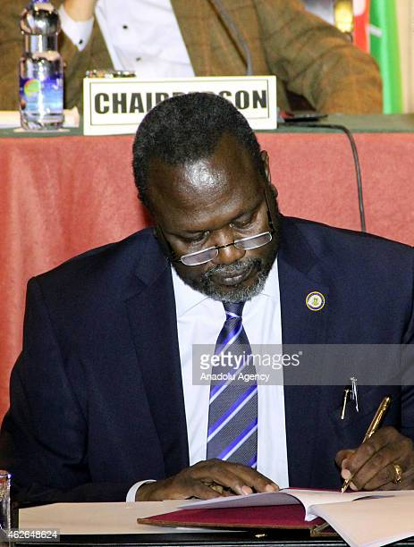 Riek Machar attends a meeting with President of South Sudan Salva Kiir Mayardit AU Commissioner for Peace and Security Ismail Chergui Kenyan...