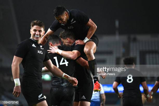 Rieko Ioane and Jordie Barrett of the All Blacks celebrate a try to Will Jordan during The Rugby Championship and Bledisloe Cup match between the New...