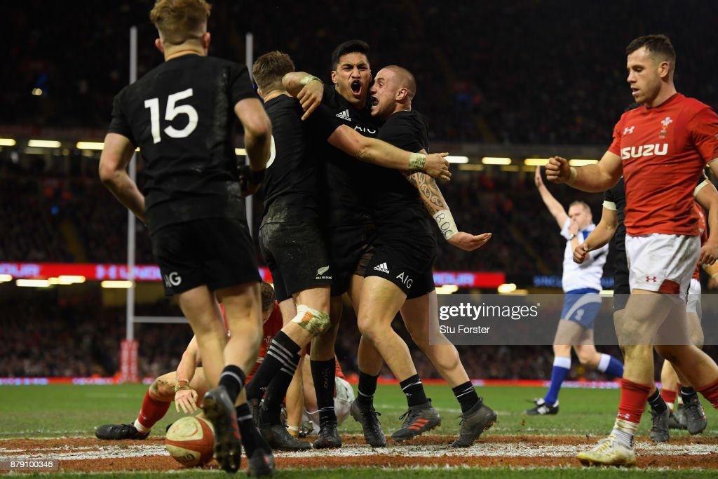 Rieko Ioane of New Zealand All Blacks celebrates his second try with TJ Perenara during the International match between Wales and New Zealand at Principality Stadium on November 25, 2017 in Cardiff, Wales.