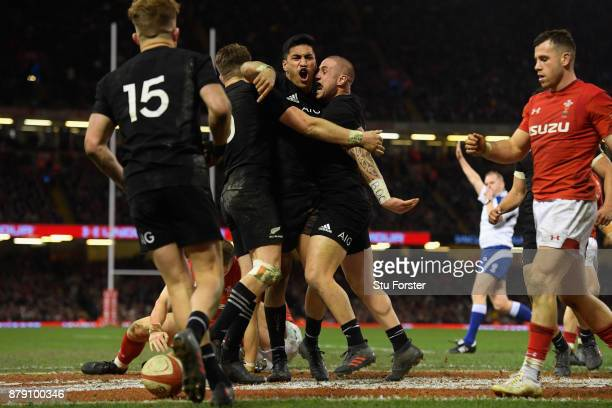Rieko Ioane of New Zealand All Blacks celebrates his second try with TJ Perenara during the International match between Wales and New Zealand at...