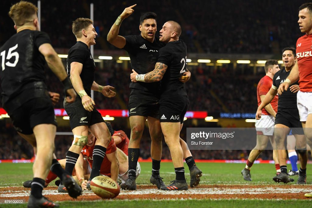 Rieko Ioane of New Zealand celebrates scoring his sides fifth try with TJ Perenara of New Zealand during the International match between Wales and New Zealand at Principality Stadium on November 25, 2017 in Cardiff, Wales.