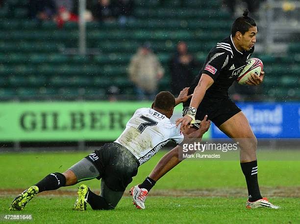Rieko Ioane of New Zealand is tackled by Osea Kolinisau of Fiji during the Emirates Airlines Rugby 7s Cup Final match between New Zealand and Fiji at...
