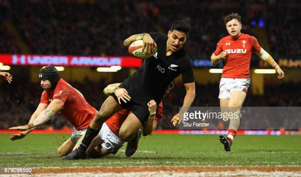 Rieko Ioane of New Zealand touches down for the fifth try during the International match between Wales and New Zealand at Principality Stadium on...