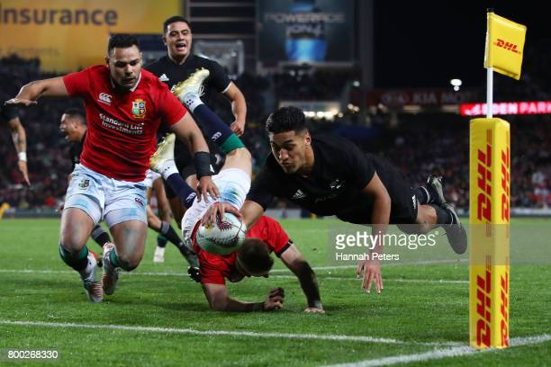 Rieko Ioane of the All Blacks dives over to score his team's second try during the first test match between the New Zealand All Blacks and the...