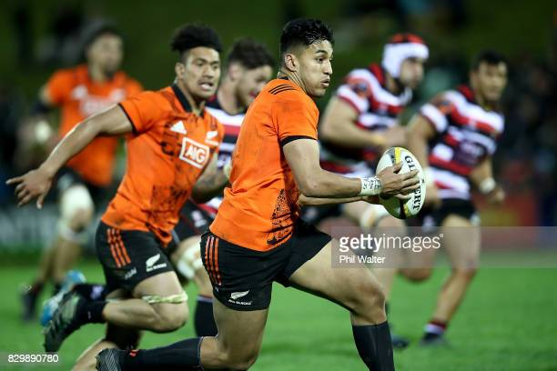 Rieko Ioane of the All Blacks is tackled during the Game of Three Halves between the All Blacks and Counties at ECOLight Stadium on August 11 2017 in...