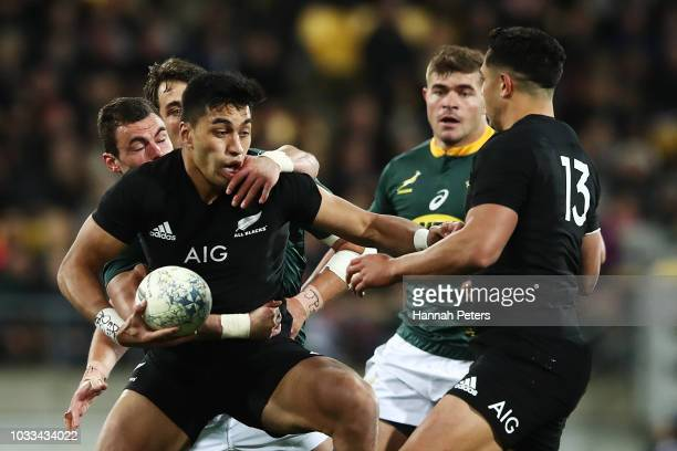 Rieko Ioane of the All Blacks makes a break during The Rugby Championship match between the New Zealand All Blacks and the South Africa Springboks at...