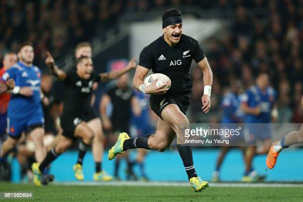 Rieko Ioane of the All Blacks makes a break to score a try during the International Test match between the New Zealand All Blacks and France at...