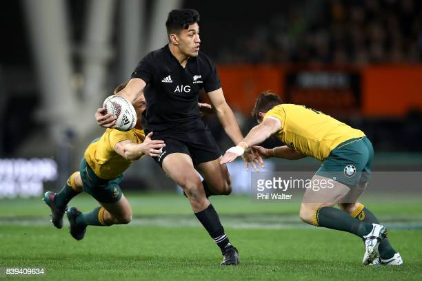 Rieko Ioane of the All Blacks passes the ball during The Rugby Championship Bledisloe Cup match between the New Zealand All Blacks and the Australia...